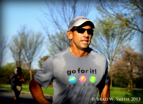 """male runner wearing shirt that says """"go for it"""""""