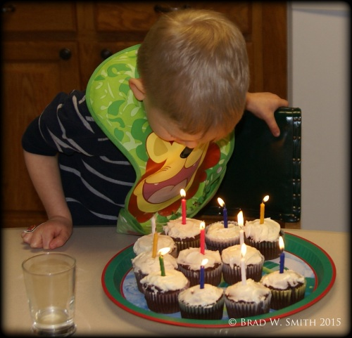 When Your Relationship is Out of Balance, Do This, LifeIsHOTBlog, birthday boy blowing out candles on cupcakes, Brad W. Smith, photographer