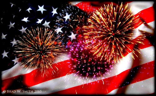 fireworks exploding against a backdrop of the American flag